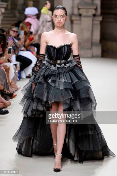 A model presents a creation by Galia Lahav during the 20182019 Fall/Winter Haute Couture collection fashion show in Paris on July 4 2018