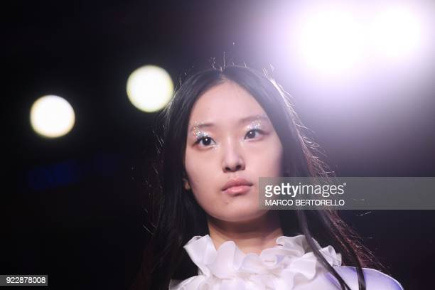 A model presents a creation by Genny during the women's Fall/Winter 2018/2019 collection fashion show in Milan on February 22 2018 / AFP PHOTO /...