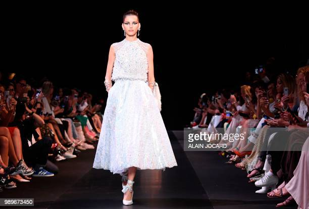 A model presents a creation by Georges Hobeika during the 20182019 Fall/Winter Haute Couture collection fashion show in Paris on July 2 2018