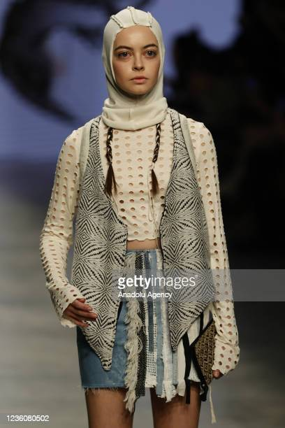 Model presents a creation by Gerda Irene during the last day of the Mercedes-Benz Fashion Week at the Museum of Moscow in Moscow, Russia on October...