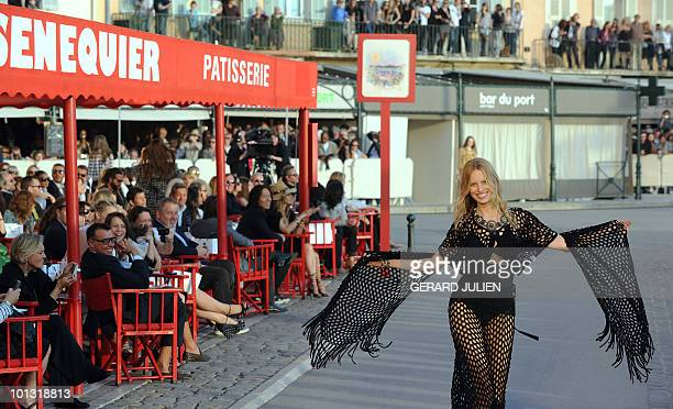 A model presents a creation by German designer Karl Lagerfeld for the Chanel 2010/11 Croisiere collection on May 11 2010 on SaintTropez harbour...