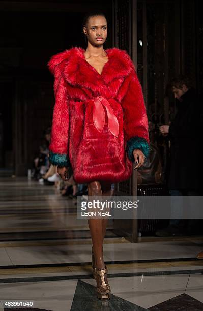 A model presents a creation by German fashion label Felder Felder during the show at the Fashion Scout venue during the 2015 Autumn / Winter London...