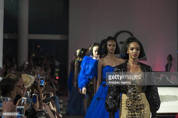 A model presents a creation by GertJohan Coetzee during the South African Fashion Week in Johannesburg South Africa on October 21 2015