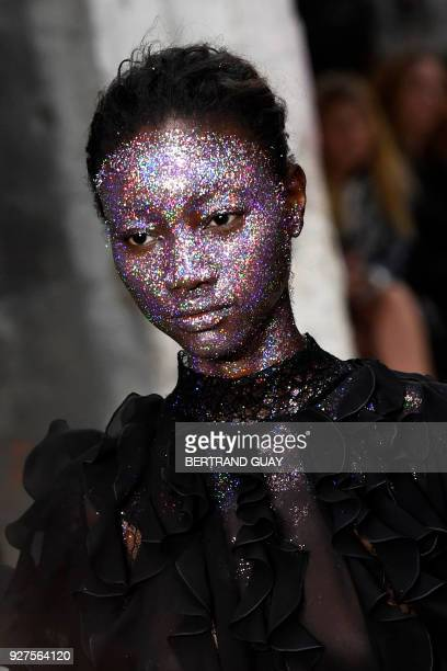 TOPSHOT A model presents a creation by Giambattista Valli during the 2018/2019 fall/winter collection fashion show on March 5 2018 in Paris / AFP...