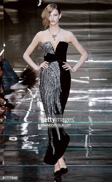 Model presents a creation by Giorgio Armani Prive during Fall-Winter 2009 Haute Couture collection show in Paris, on June 30, 2008. AFP PHOTO...