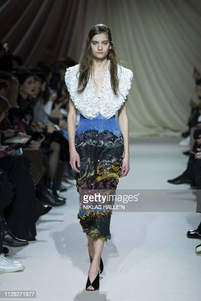 A model presents a creation by Greek designer Mary Katranzou during her 2019 Autumn / Winter collection catwalk show at London Fashion Week in London...