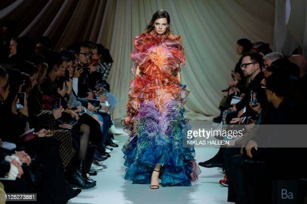 TOPSHOT A model presents a creation by Greek designer Mary Katranzou during her 2019 Autumn / Winter collection catwalk show at London Fashion Week...