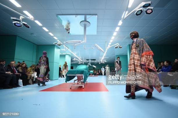 TOPSHOT A model presents a creation by Gucci during the women's Fall/Winter 2018/2019 collection fashion show in Milan on February 21 2018