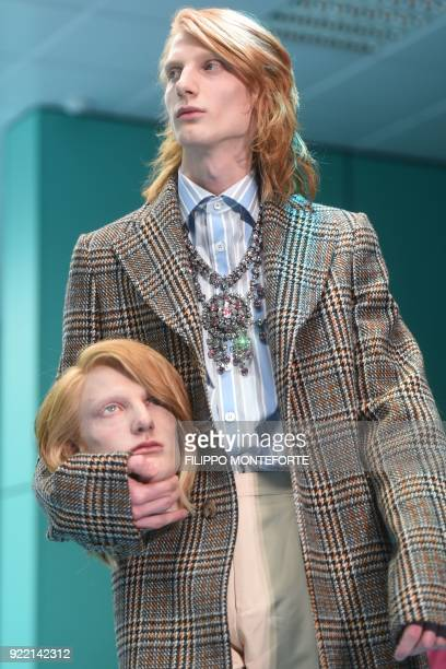 Model presents a creation by Gucci during the women's Fall/Winter 2018/2019 collection fashion show in Milan, on February 21, 2018. / AFP PHOTO /...