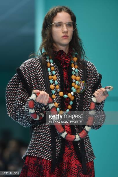 A model presents a creation by Gucci during the women's Fall/Winter 2018/2019 collection fashion show in Milan on February 21 2018 / AFP PHOTO /...
