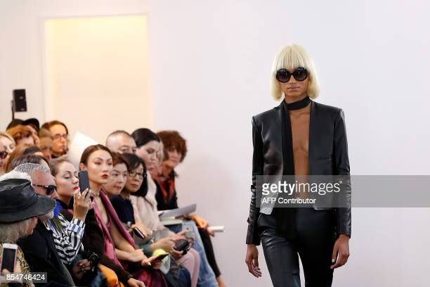 A model presents a creation by Guy Laroche during the women's 2018 Spring/Summer readytowear collection fashion show in Paris on September 27 2017...