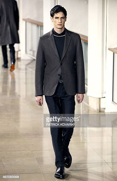 A model presents a creation by Hermes during the men's Fall/Winter 2015 readytowear collection fashion show in Paris on January 24 2015 AFP PHOTO /...