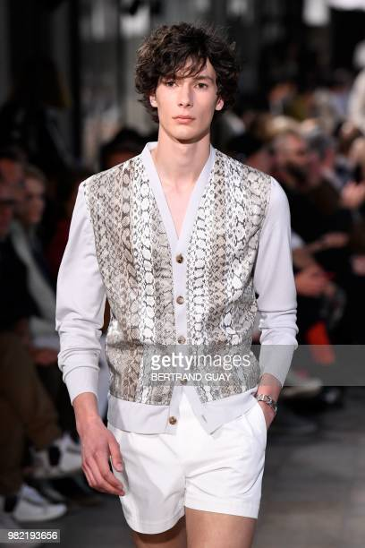 A model presents a creation by Hermes during the men's Spring/Summer 2019 collection fashion show on June 23 2018 in Paris