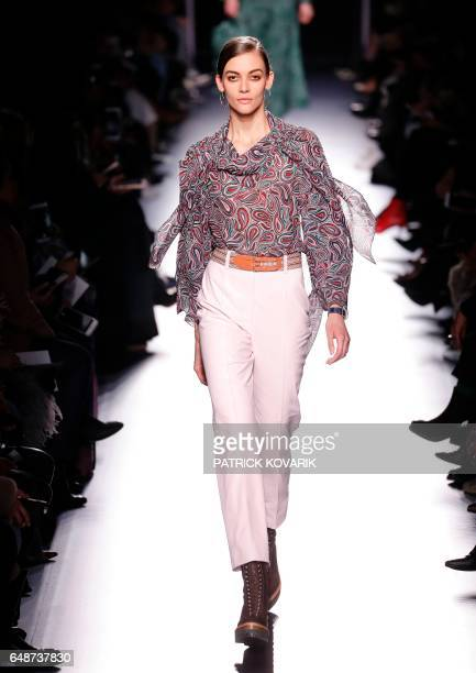 A model presents a creation by Hermes during the women's FallWinter 20172018 readytowear collection fashion show in Paris on March 6 2017 / AFP PHOTO...