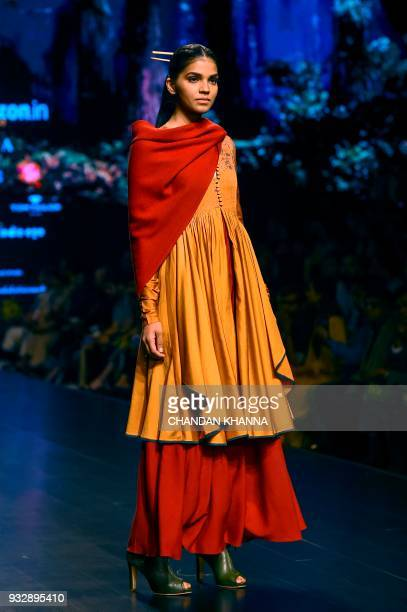 A model presents a creation by Indian designer Anju Modi during the Amazon India Fashion Week Autumn Winter 2018 in New Delhi on March 16 2018 / AFP...