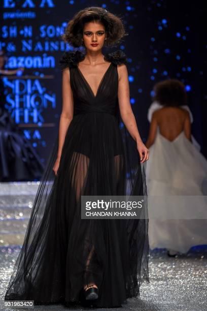 A model presents a creation by Indian designer Ashish N Soni Gauri Nainika Karan during the Amazon India Fashion Week Autumn Winter 2018 in New Delhi...