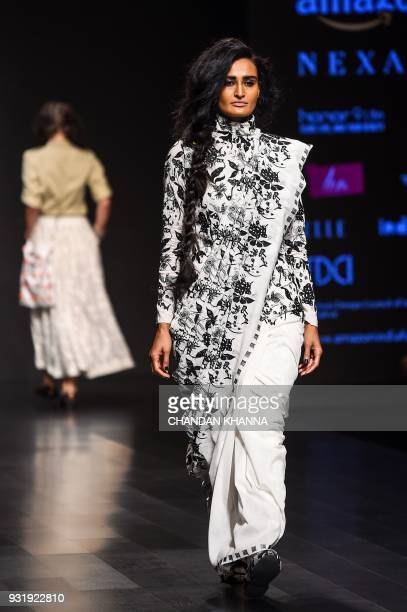 A model presents a creation by Indian designer David Abraham and Rakesh Thakore during the Amazon India Fashion Week Autumn Winter 2018 in New Delhi...