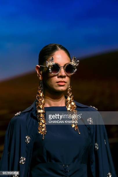 A model presents a creation by Indian designer Eshaa Amiin during the Amazon India Fashion Week Autumn Winter 2018 in New Delhi on March 16 2018 /...