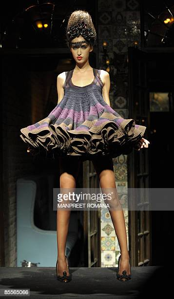 A model presents a creation by Indian designer Rohit Bal on March 23 during the grand finale of the Delhi Fashion Week in New Delhi The Dehi Fashion...