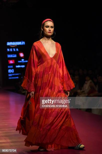 A model presents a creation by Indian fashion designer Aneeth Arora during the Amazon India Fashion Week Autumn/Winter 2018 in New Delhi on March 17...
