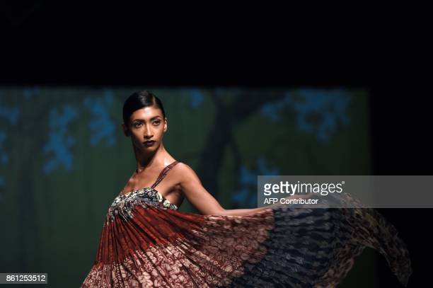 A model presents a creation by Indian fashion designer Jyoti Sharma during the Amazon India Fashion Week spring summer 2018 in New Delhi on October...