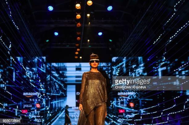 A model presents a creation by Indian fashion designer Namrata Joshipura during the Amazon India Fashion Week Autumn/Winter 2018 in New Delhi on...