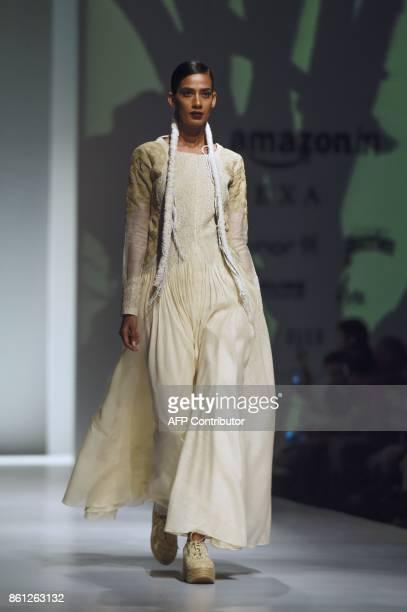 A model presents a creation by Indian fashion designers Ekta Jaipuria and Ruchira Kandhari during the Amazon India Fashion Week spring summer 2018 in...