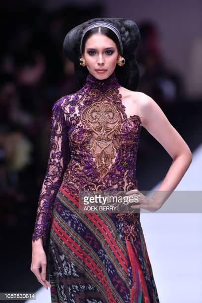 A model presents a creation by Indonesian designer Anne Avantie during the 2019 Jakarta Fashion Week in Jakarta on October 23 2018 The 2019 Jakarta...