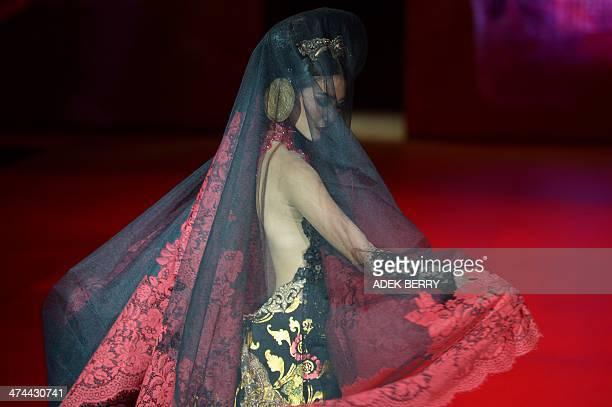 A model presents a creation by Indonesian designer Anne Avantie on the last day of the Indonesia Fashion Week in Jakarta on February 23 2014 AFP...
