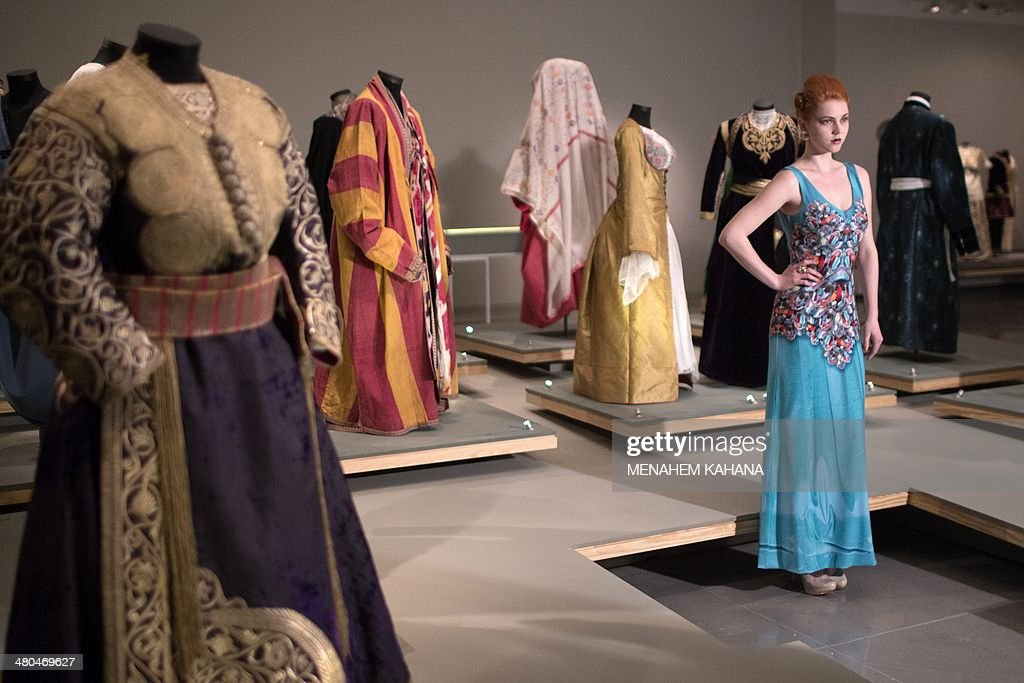A model presents a creation by israeli designer faro blau that is a model presents a creation by israeli designer faro blau that is inspired by an ancient jewish indian dress on march 25 2014 during a fashion show as part publicscrutiny Images