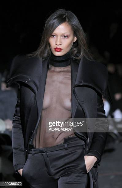 Model presents a creation by Italian designer Riccardo Tisci for Givenchy during the autumn-winter 2010/2011 ready-to-wear collection show on March...