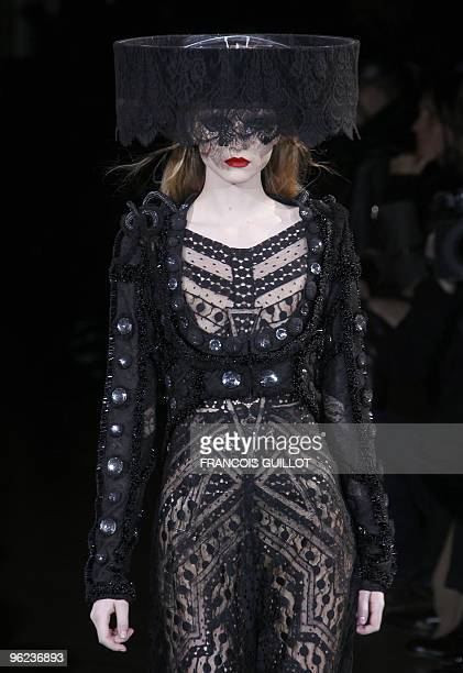 A model presents a creation by Italian designer Riccardo Tisci for Givenchy during the springsummer 2010 haute couture collection show on January 26...