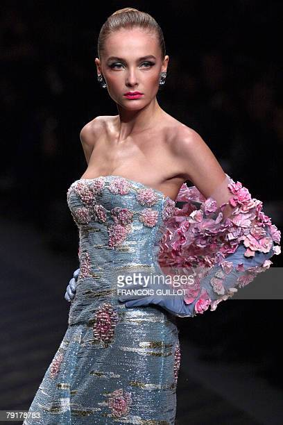 Model presents a creation by Italian designer Valentino during his Spring/Summer 2008 Haute Couture collection show in Paris, 23 January 2008....