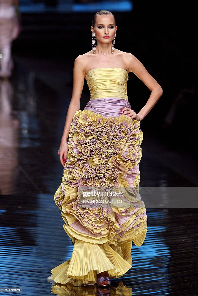 A model presents a creation by Italian designer Valentino during his Spring/Summer 2008 Haute Couture collection show in Paris, 23 January 2008. Valentino, the 75-year-old high-fashion guru, retires after 45 years in the business.
