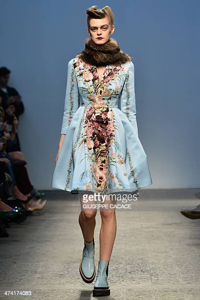 A model presents a creation by Italian fashion designer Antonio Marras as part of the Milan fashion week Autumn/Winter 2014 collections on February...