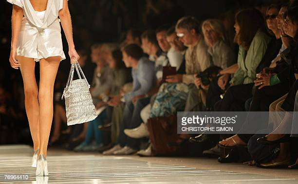 A model presents a creation by Italian fashion designer Roccobarocco during the Spring/Summer 2008 collections of the Milan readytowear fashion shows...