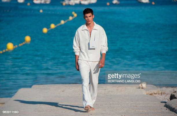 A model presents a creation by Jacquemus during a fashion show at the Sormiou Calanque in Marseille southeastern France on June 25 2018