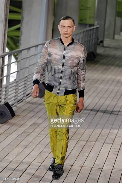 Model presents a creation by Japanese designer Arashi Yanagawa for the label John Lawrence Sullivan during his men's spring-summer 2012 men's fashion...