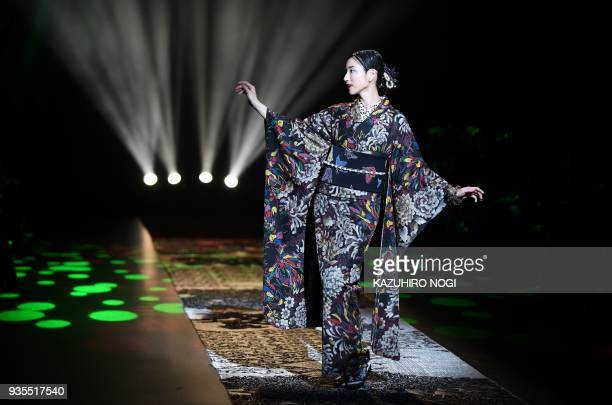 TOPSHOT A model presents a creation by Japanese designer Jotaro Saito for his 2018 autumn/winter collection at Tokyo Fashion Week in Tokyo on March...