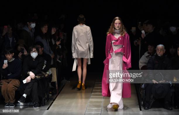 A model presents a creation by Japanese designer Keisuke Yoshida for his 2018 autumn/winter collection at Tokyo Fashion Week in Tokyo on March 21...