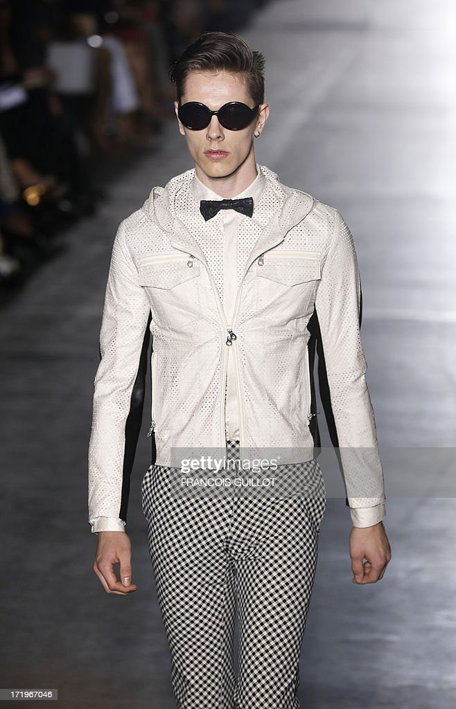 A model presents a creation by Japanese designer Rynshu during the men's spring/summer 2014 ready-to-wear fashion show on June 30, 2013 in Paris.