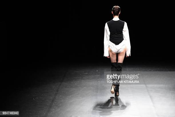 TOPSHOT A model presents a creation by Japanese fashion brand DressedUndressed from their 2018 autumn/winter collection at the Tokyo Fashion Week in...