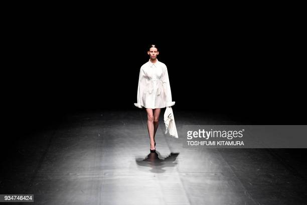 A model presents a creation by Japanese fashion brand DressedUndressed from their 2018 autumn/winter collection at the Tokyo Fashion Week in Tokyo on...