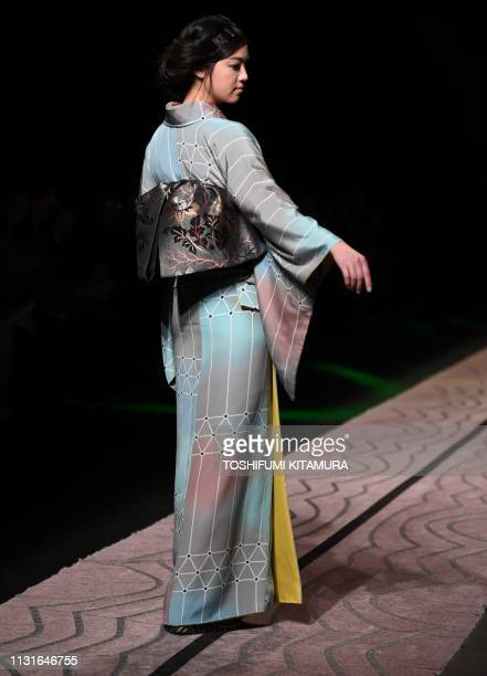 A model presents a creation by Japanese fashion designer Jotaro Saito at Tokyo Fashion Week on March 20 2019