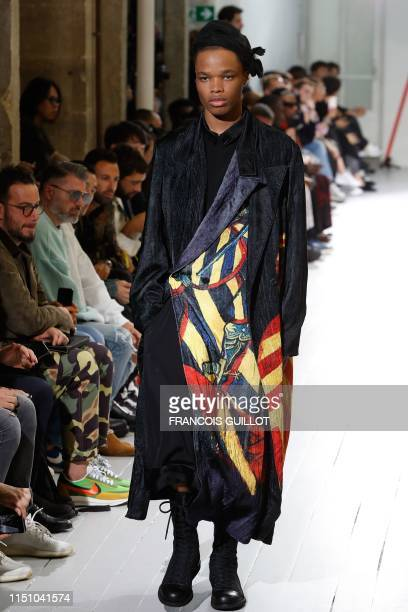 Model presents a creation by Japanese fashion designer Yohji Yamamoto during the Men's Spring/Summer 2020 fashion show in Paris, on June 20, 2019.