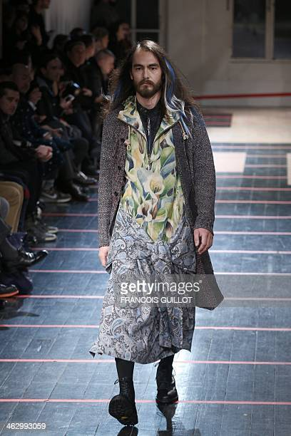 Model presents a creation by Japan's Yohji Yamamoto during the Fall/Winter 2014-2015 men's fashion show in Paris on January 16, 2014. AFP PHOTO...