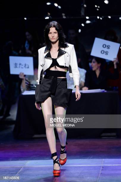 A model presents a creation by Jean Paul Gaultier during the 2014 Spring/Summer readytowear collection fashion show on September 28 2013 in Paris AFP...