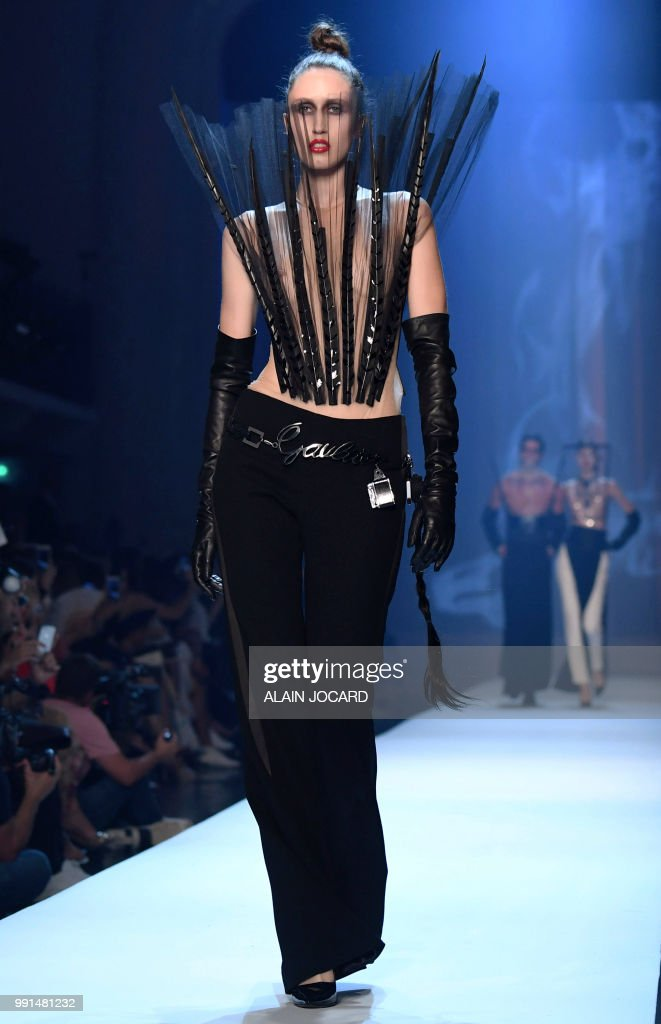model-presents-a-creation-by-jeanpaul-gaultier-during-the-20182019-picture-id991481232