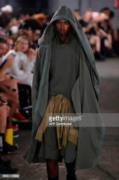 A model presents a creation by Julius during the Men's Fashion Week for the Spring and Summer 2018 collection in Paris on June 21 2017 / AFP PHOTO /...