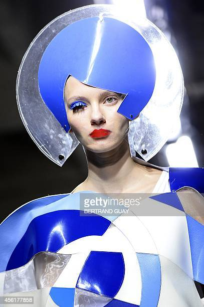 Model presents a creation by Junya Watanabe during the 2015 Spring/Summer ready-to-wear collection fashion show, on September 27, 2014 in Paris. AFP...